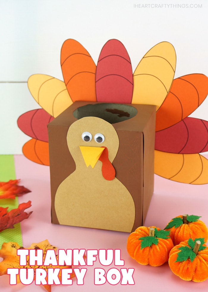 """Vertical close up image of thankful turkey box made out of an empty tissue box. Words """"Thankful Turkey Box"""" written in bottom left corner of image."""