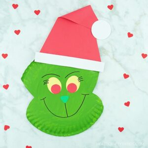 Use our free template to create this fun paper plate Grinch craft. Fun Christmas craft for kids and paper plate Christmas crafts for kids.