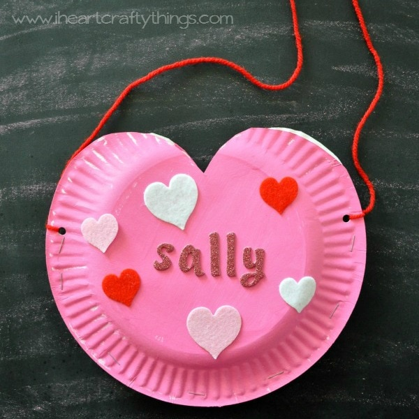 Use your hole punch to punch a hole on the sides of the paper plate hearts. Tie a piece of yarn or string to the holes and you have a hanging ... & Paper Plate Heart Valentine\u0027s Holder | I Heart Crafty Things