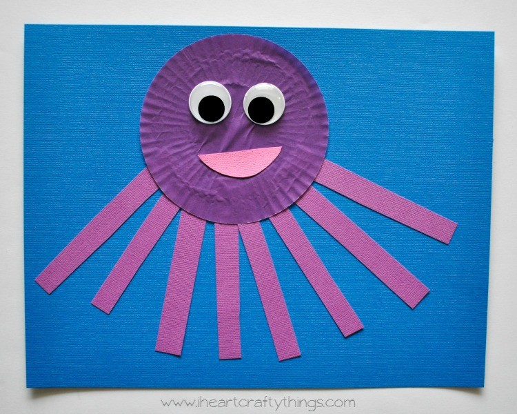 Glue your purple cupcake liner and tentacles onto your blue cardstock paper. Cut a mouth out of your pink cardstock paper and then glue it onto your Octopus ...  sc 1 st  I Heart Crafty Things & Cupcake Liner Octopus Kids Craft | I Heart Crafty Things