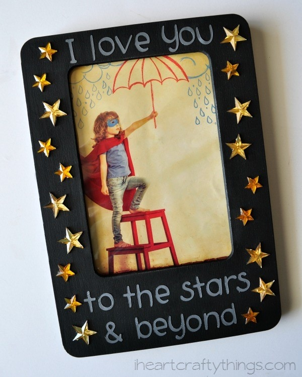 3 get out the star embellishments from your junk drawer kit we opted to use only the gold stars but do whatever you want glue them all over the empty - Mothers Day Pictures Frames