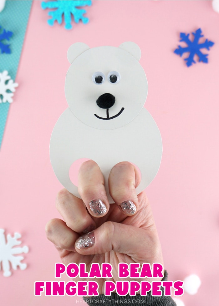 """Close up vertical image of adult with their fingers in the polar bear puppets showing how to use it with the words """"polar bear finger puppets"""" on the bottom of the photo."""