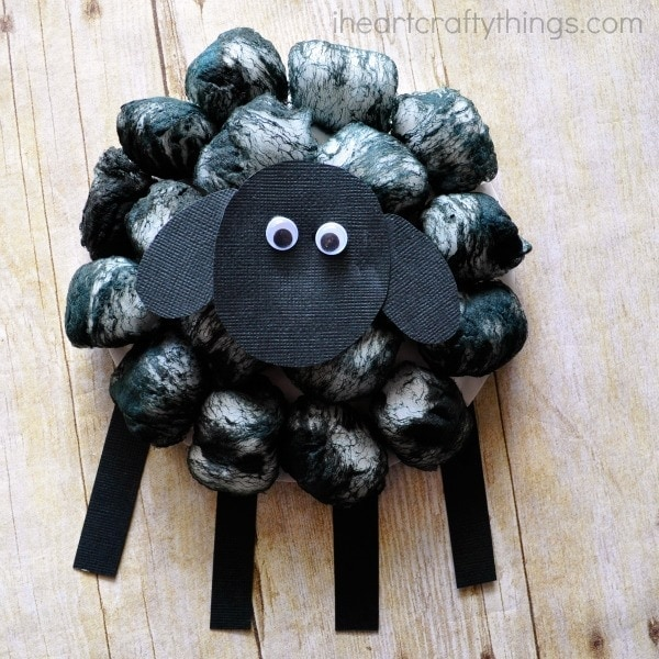 Square image of finished cotton ball sheep craft.