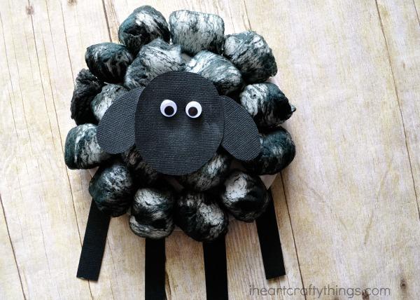 Close up image of finished cotton ball black sheep craft.