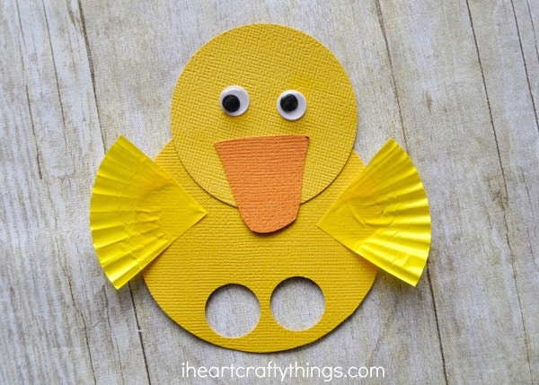 close up image of yellow duck finger puppet.