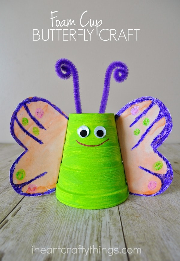 "Vertical image of green and purple butterfly craft with the words ""Foam Cup Butterfly Craft"" in the top center."