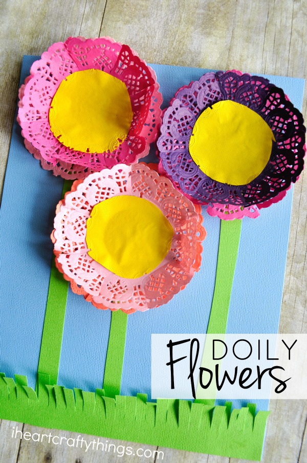 """Vertical close up image of flowers craft with the words """"Doily Flowers"""" in the bottom right corner."""