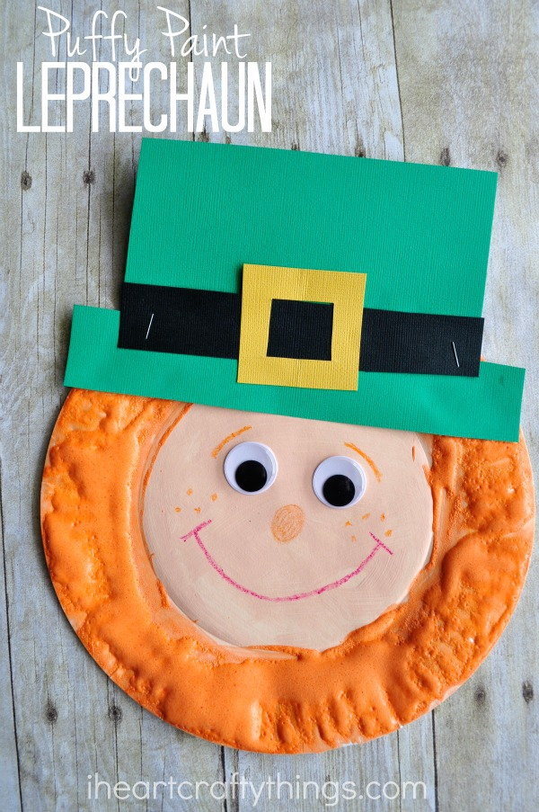 """Vertical image of finished St. Patrick's Day craft with the words """"Puffy Paint Leprechaun"""" in the top left corner."""
