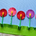 Close up image of flowers craft made from painted q-tips and paper.