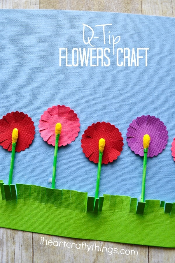 "Vertical close up image of flowers craft with the words ""Q-Tip Flower Craft"" in the top right corner."