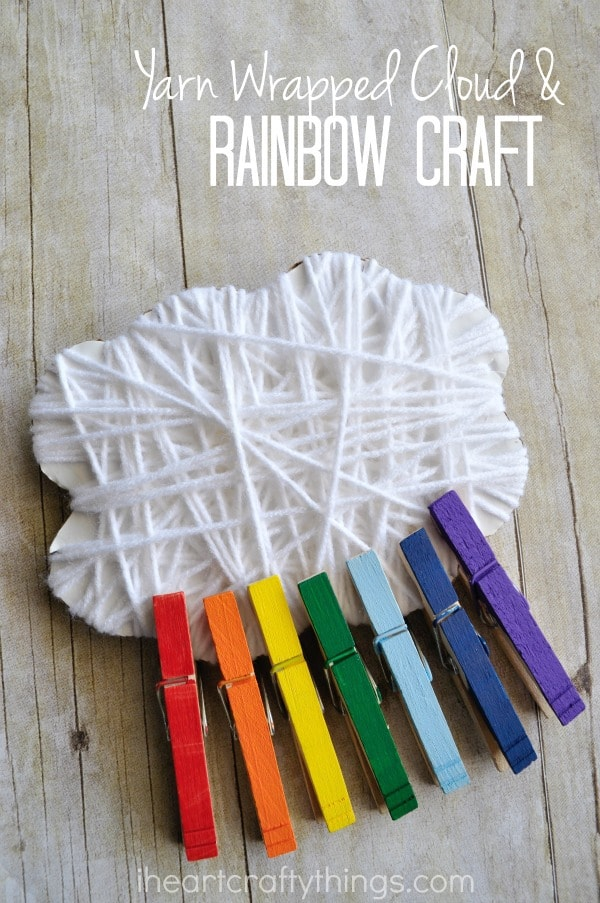 "Vertical image of yarn wrapped cloud and rainbow craft put together with the words ""Yarn Wrapped Cloud & Rainbow Craft""."