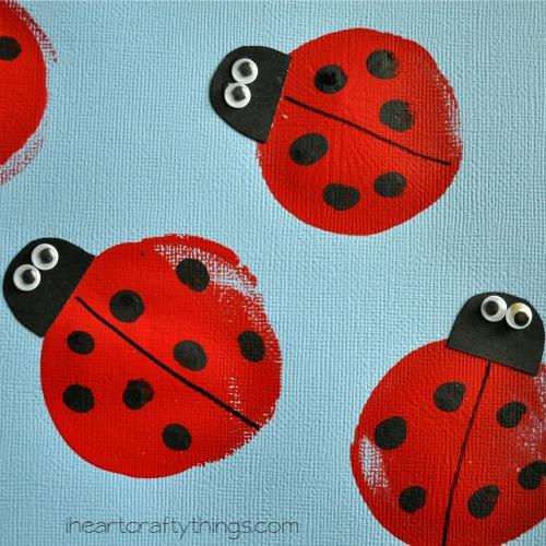 close up image of black fingerprints on balloon printed ladybug craft.