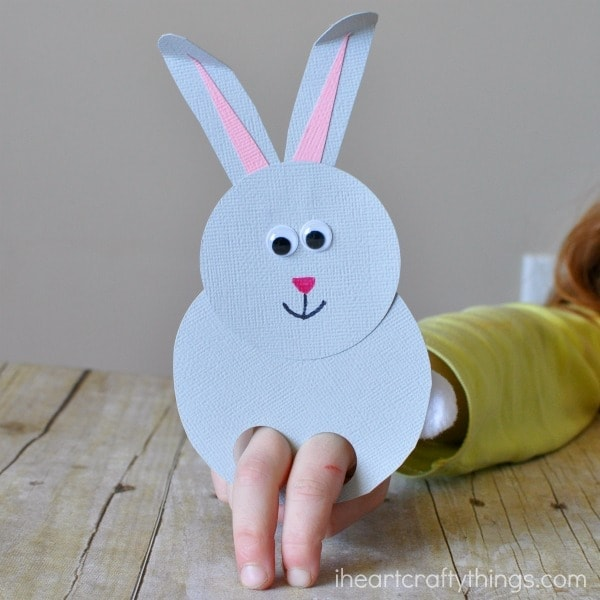 child playing with a bunny finger puppet