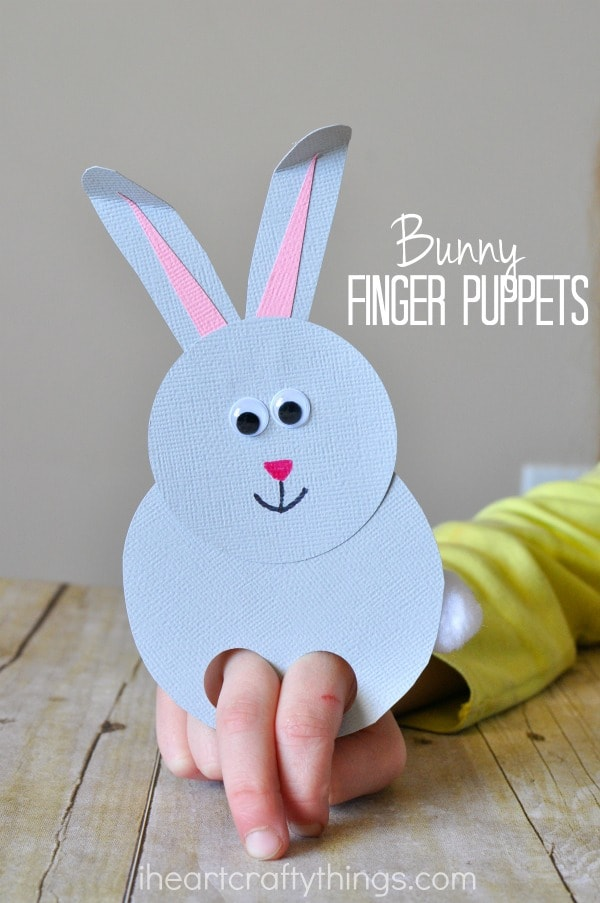 """Vertical image of child playing with bunny finger puppet with the words """"bunny finger puppets"""" in the top right corner."""