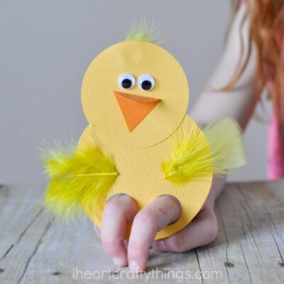 child playing with a chick finger puppet craft