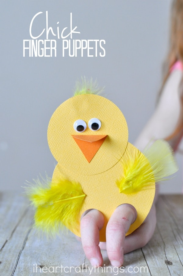 "Vertical image of a child playing with a chick finger puppet with the words ""chick finger puppets"" in the top left corner."