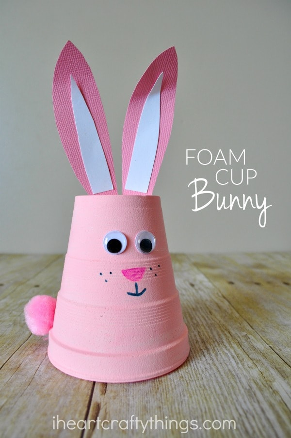 "Vertical close up image of bunny craft with the words ""Foam Cup Bunny"" in the middle right side of the photo."
