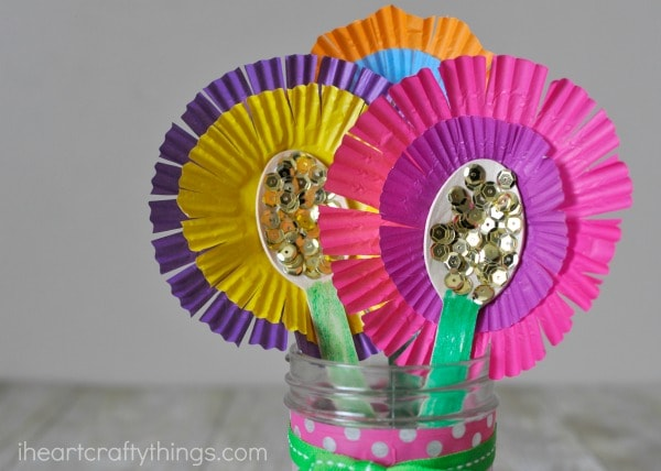 close up image of flower bouquet made out of wooden spoons and cupcake liners.