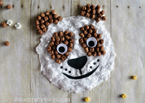 What the panda craft looks like after child glues a nose, mouth and whiskers onto it.