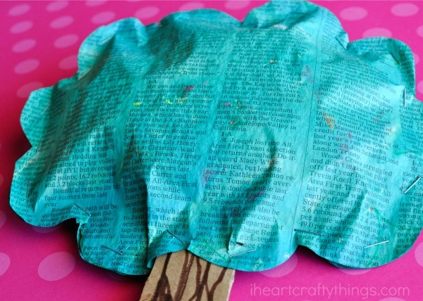 Close up image of puffy newspaper tree craft.