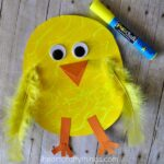 Close up image of finished paper chick craft with a yellow Fun Chalk marker laying in the top right corner.
