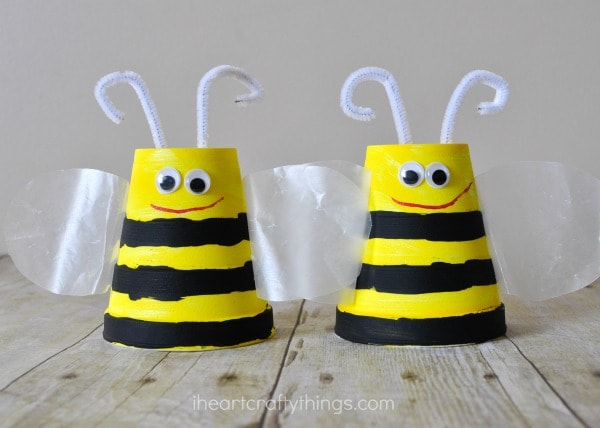 close up image of two foam cup bee crafts for kids to make