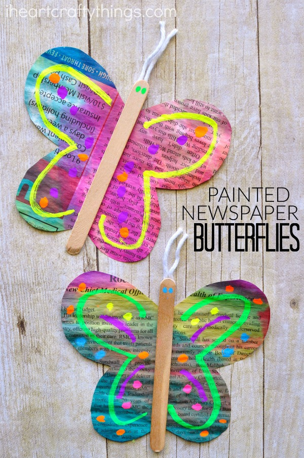 "vertical image of two painted newspaper butterfly crafts with the words ""painted newspaper butterflies""."