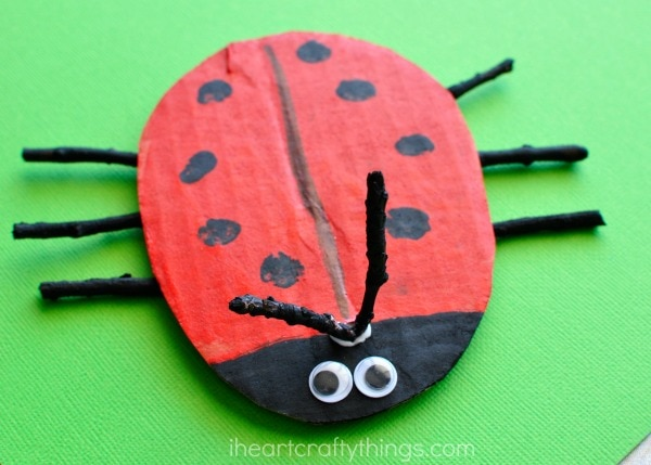 close up image of the y-shaped stick antennae of the cardboard ladybug craft