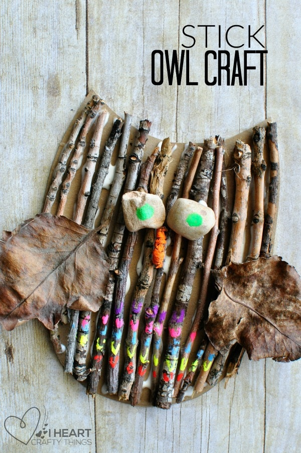 """vertical close up image of owl craft with the words """"stick owl craft"""" in the top right corner."""