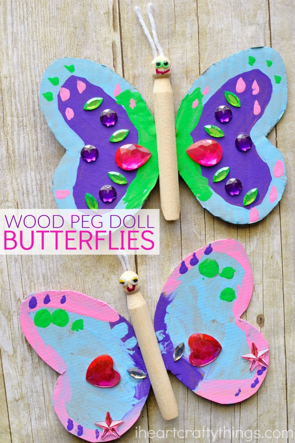 vertical image of two butterfly crafts made out of cardboard and wood peg dolls.