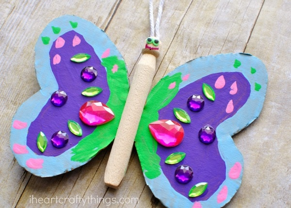 close up image of wood peg butterfly craft.