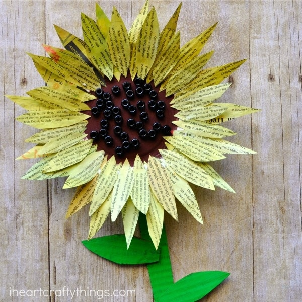 This painted newspaper sunflower craft is perfect for a summer kids craft. Watercolor painted newspaper brings great texture and vibrant colors to crafts. Great kids craft made from recyclables, flower craft for kids, and paper plate kids craft.