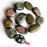 This patterned rocks snake craft is like a busy bag and a craft rolled into one. Kids will love learning about and getting creative with patterns making a colorful snake craft. Great summer kids craft and boredom buster activity for kids.