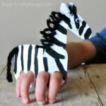 This galloping finger puppet zebra craft is so fun for kids to make and kids will love playing with their zebra craft by making it gallop around the house. Fun animal crafts for kids, zebra craft, zoo crafts, summer kid crafts, preschool crafts and play based learning activity for kids.