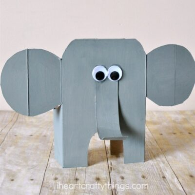 Here is a diy tutorial for how to turn a cereal box into an awesome cereal box elephant craft. Little ones might have trouble with cutting the cereal box but adults can do the cutting and kids will love painting, decorating and finishing their elephant craft. Fun animal craft for kids, recyclable kids craft and summer craft for kids.