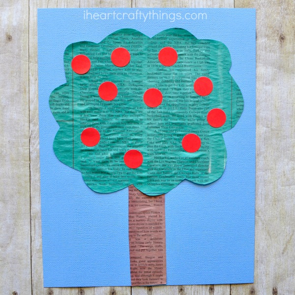 This simple painted newspaper apple tree craft is perfect for a preschool apple theme and fall kids craft. Fun apple craft for kids, recycled newspaper craft, preschool craft and fall craft for kids.