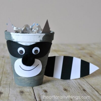 This cute The Kissing Hand Raccoon Craft is perfect as a back to school kids craft and turns into a fun treat container that can be taken to school to hand out kisses to classmates. Or if you are a teacher you might love to incorporate it for the first day of school after reading The Kissing Hand.