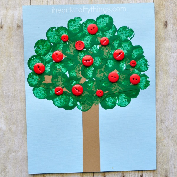 This wine cork stamped apple tree craft is not only a great excuse for opening up a bottle of wine this evening after the kids go to bed, but it also makes a fabulous fall kids craft. Fun apple craft for kids and preschool kids craft.