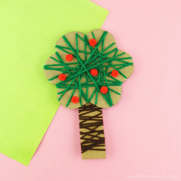 Square close up image of yarn wrapped apple tree craft for preschoolers to make.