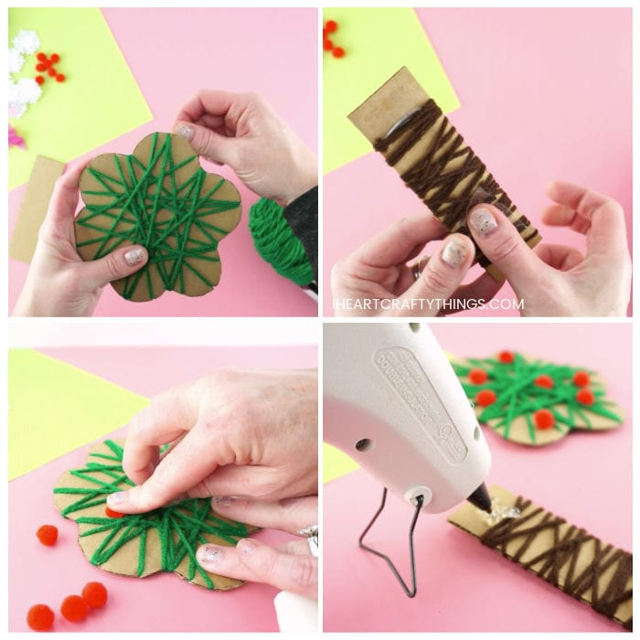 Four image collage showing adult wrapping the cardboard tree with green yarn, then wrapping the tree trunk with brown yarn, gluing red poms for apples on the tree and then hot gluing the tree top onto the tree trunk.