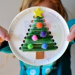 This plastic lid Christmas tree sewing craft is festive, cute and is awesome for a fine motor activity for kids. Fun Christmas craft for kids.