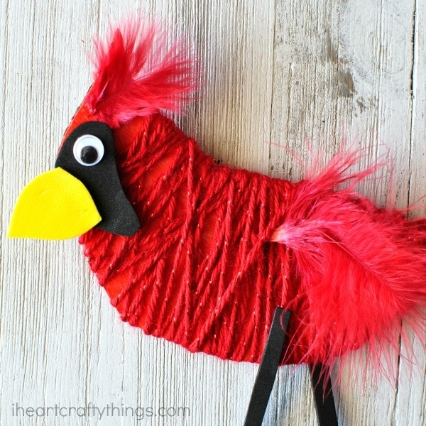 This yarn wrapped cardinal craft is bright and beautiful and perfect for a winter kids craft and for strengthening fine motor muscles.