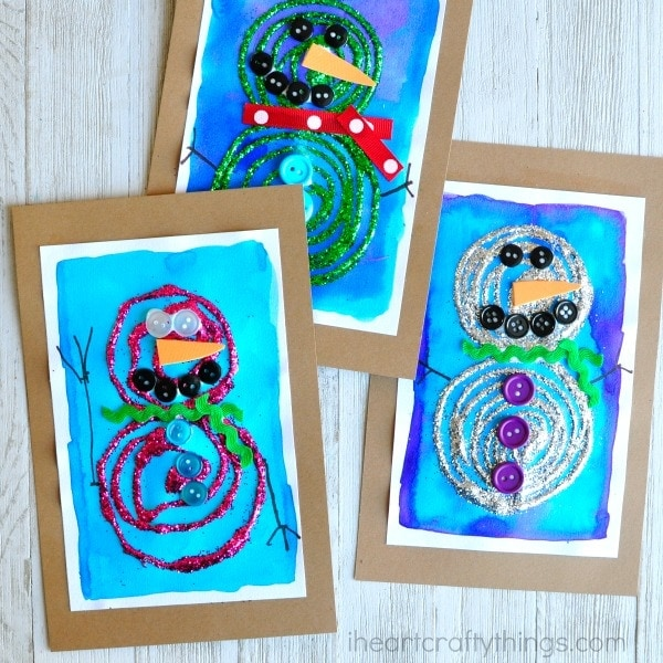 This swirly glue and glittery snowman craft is bright, gorgeous and perfect for displaying all winter long. Fun preschool craft and winter kids craft.