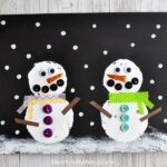 Read Snowmen at Night after building a snowman on a snowy, winter day and afterwards can get crafty creating this snowmen at night craft. Fun snowman craft for kids and winter kids craft.