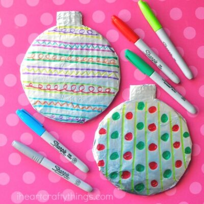 Kids will love getting creative designing a Tin Foil Christmas Bauble Craft. Great Christmas Craft for kids of all ages, especially preschoolers.