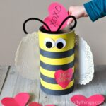 This Bee Valentine Box made out of an oatmeal container is simple to make and is perfect for Valentine's Day. Awesome DIY Valentine's Box.