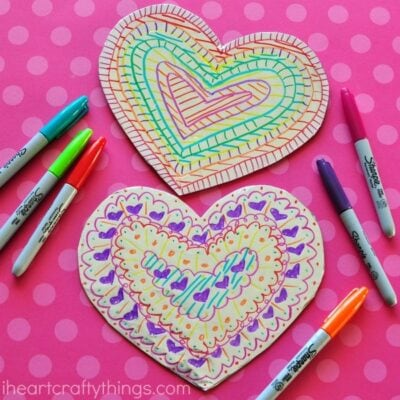 This tin foil heart Valentine's Day craft is shiny and colorful and makes a fabulous craft for kids of all ages. Fun toddler craft, preschool craft and Valentine's Day crafts for kids.