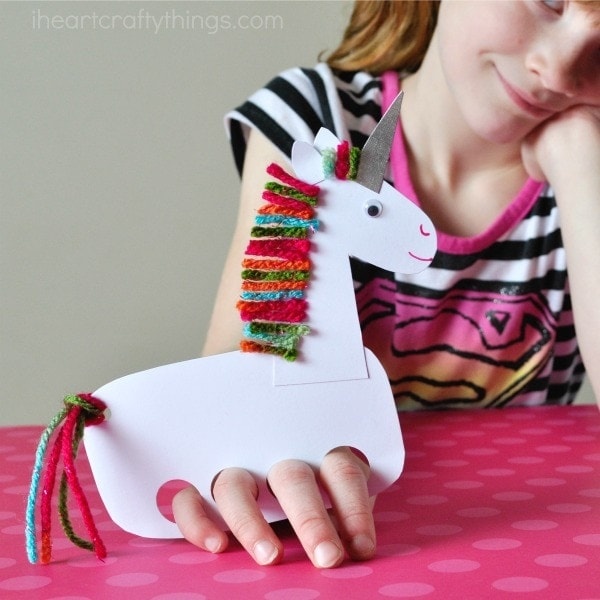 These incredibly cute and playful unicorn puppets make a fun kids craft and evergreen craft for any time of the year. Fun unicorn kids craft, winter kids craft, spring kids craft, summer kids craft, fall kids craft, crafts for pretend play and preschool craft.