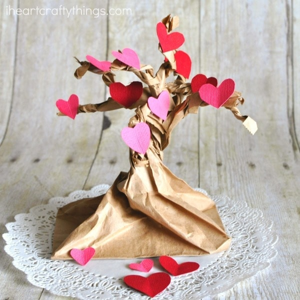 Pretty Valentine Heart Tree Craft that goes along with the book The Day it Rained Hearts. Fun Valentine's Day Craft for kids.