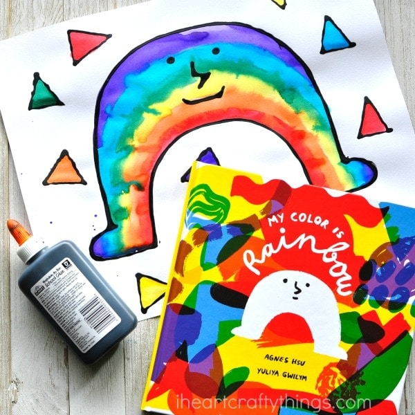 This black glue and watercolor resist rainbow craft makes a perfect spring craft for kids and goes along great with the book My Color is Rainbow by Agnes Hsu. Fun preschool art activity, rainbow kids craft and book inspired craft.